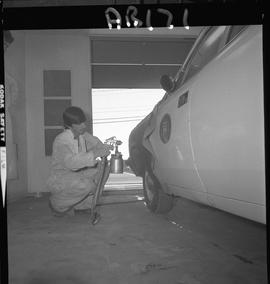 BC Vocational School image of Autobody program student repairing a vehicle in the shop; spraying ...