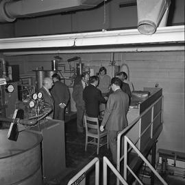 BCIT Programs Forestry Technology ; group of men standing in a mechanical room ; two men shaking ...