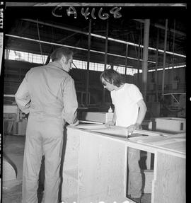 B.C. Vocational School; inside of the Carpentry Trades shop of an instructor and a student, parti...