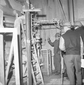 Forestry, Wood fiber BCIT tour, November 26, 1965; group of men listening to a tour guide