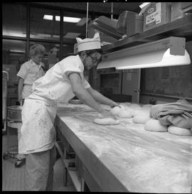 BC Vocational School Cook Training Course ; student rolling dough