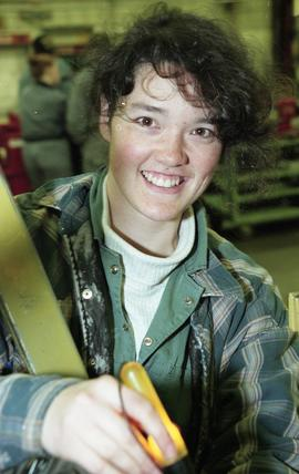 BCIT women in trades; heavy duty, students in uniforms using mechanical tools and equipment [9 of...