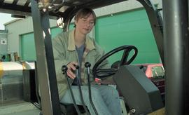 BCIT women in trades; forklift training, students driving a forklift [2 of 15 photographs]