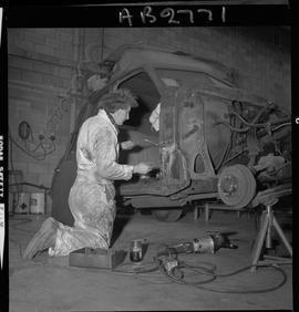 BC Vocational School image of Autobody program student working on a vehicle in the shop [5 of 5 p...