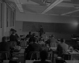 Business Management, 1966; instructor lecturing to accounting students