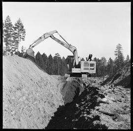 Heavy duty equipment operator, Nanaimo ; side view of an Insley excavator