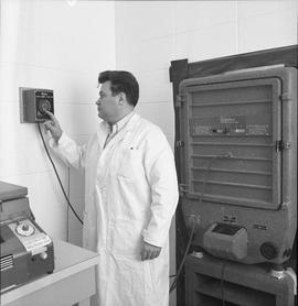 BCVS Graphic arts ; a man adjusting settings for a Robertson 320 dark room camera