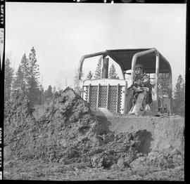 Heavy duty equipment operator, Nanaimo ; man operating a bulldozer moving dirt [2 of 9]