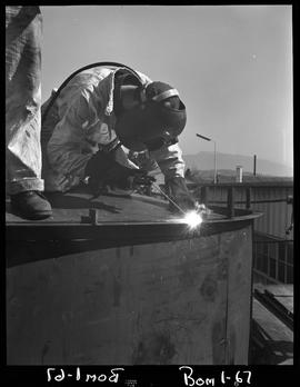 B.C. Vocational School; Boiler making program students welding a large tank outside at Burnaby ca...