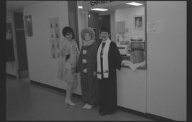General Office staff dressed as a housewife (?), clown, and priest [5 of 11 photographs]