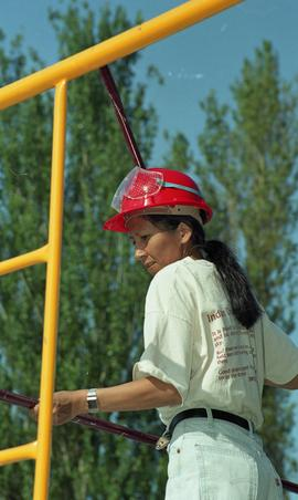 Pre-trade Aboriginal women; wearing hard hats and piecing together equipment [6 of 13 photographs]