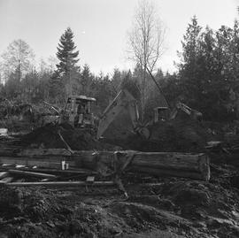 Heavy duty equipment operator, Nanaimo ; two men operating excavators moving dirt ; logs and othe...