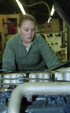 BCIT women in trades; heavy duty, students in uniforms using mechanical tools and equipment [13 o...