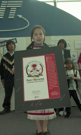 "BCIT open house '98, First Nations youth holding a signed poster that reads ""First Nations P..."