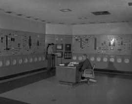 Instrumentation, 1964; an instrumentation lab ; one man sitting at a desk and one man standing ne...
