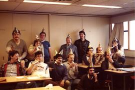 Aircraft Maintenance students with Instructor C. Gordon Peters; party hats, celebrating [1 of 2 p...