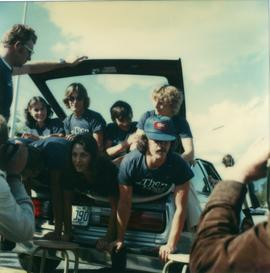 Student Rally 1984 ; a group of students piled into the trunk of a car [3 of 3]