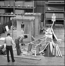 Carpentry apprenticeship contest, Burnaby campus, 1978 ; apprentice cutting wood for their projec...