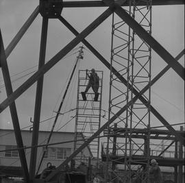 Structural steel, 1971; two students assembling scaffolding; other students working below