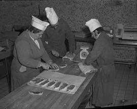 Meat cutting, 1968;  three people cutting pork chops
