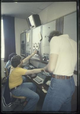 Broadcast Communications; three men working in a editing room