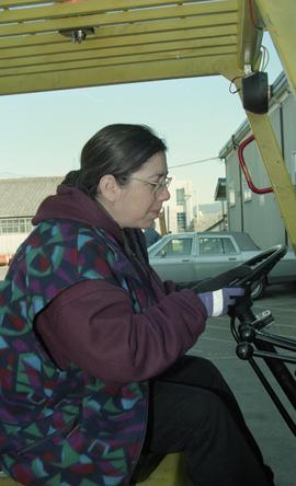 BCIT women in trades; forklift training, students driving a forklift [7 of 15 photographs]