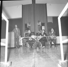 CVA Convention, 1969 ; man standing at podium ; three men sitting at a table with microphones