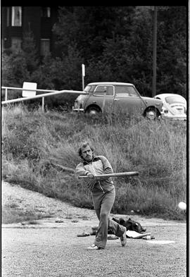 BCIT image of a man batting in a staff softball game.