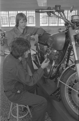Pacific Vocational Institution ; a student working on a Yamaha motorcycle and the instructor talking