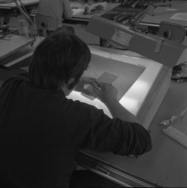 Map drafting, Victoria, 1968; man using a light table to trace a map onto paper
