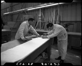 B.C. Vocational School image of a Carpentry Trades instructor and a student reading building plan...