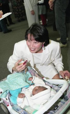 BCIT open house '98, First Nations woman crouching down beside a baby in a stroller