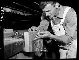 B.C. Vocational School image of a Carpentry Trades student installing a door latch in the Carpent...