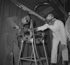 Welding, Dawson Creek, 1968; instructor talking to a student using welding equipment