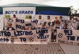Jackie Azar - kids from the Metro-Ford Soccer Club holding up thank you posters for Fox 99.3 and ...