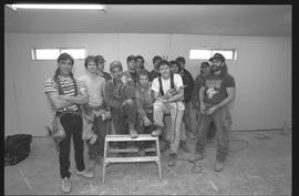 Students holding power tools and posing for a group shot during gym construction [7 of 8 photogra...
