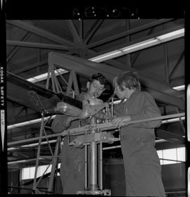 BC Vocational School; Aeronautics students working on a helicopter inside the hangar in Burnaby