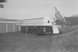 BCIT Burnaby campus; a trailer with a satellite dish parked behind wire fencing [1 of 2]
