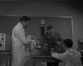 Instrumentation, 1966; three men using a Conductivity Bridge model RC 1682