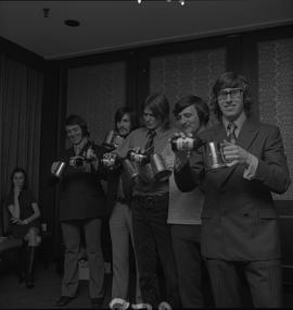 Hockey presentation, Plaza 500, 1972; award recipients pouring beer into their steins