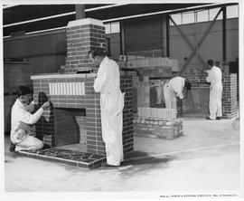 Bricklaying; Four men working on a brick fireplace; Photo by the Division of Vocational Curriculu...