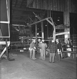 BCIT Programs Forest Products Technology ; group of people on the ground floor of a saw mill