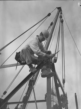 Structural steel, 1968; worker tightening a bolt on a steel structure