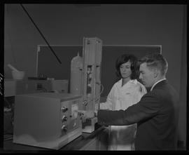 Food Processing Technology, 1966; woman in a lab coat and man in a suit using food processing equ...