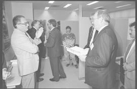 Minister of Advanced Education, Training and Technology, Bruce Strachan and staff talking near an...