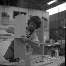 Carpentry apprenticeship contest, Burnaby campus, 1978 ; apprentice hammering and building a shel...
