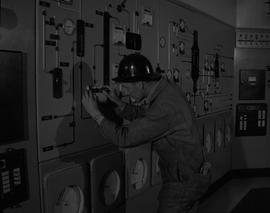 Instrumentation, 1964; man wearing a hard hat fixing a piece of instrumentation equipment [1 of 2]