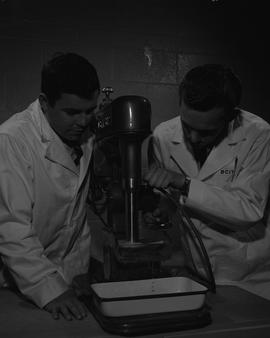 Mining; two men in lab coats testing mining samples