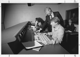 Broadcast Communications; Associate Dean Brian Antonson (standing) looks on as Television instruc...