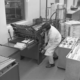BCVS Graphic arts ; a man adjusting a paper folding machine
